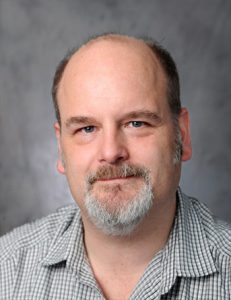 john gregory petrostrat director micropaleontologist stratigrapher staff photo